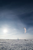 Kite boarders in snowy landscape Royalty Free Stock Photos