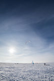 Kite boarders in wintry landscape Royalty Free Stock Photos