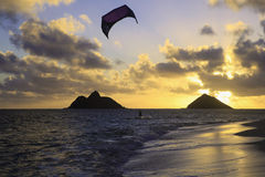 Kite boarding at daybreak Royalty Free Stock Photography