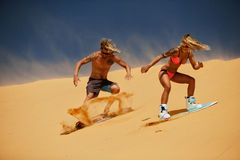 Sand boarding Stock Image