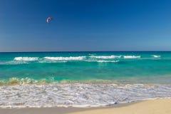 Kite boarding. Man riding his kiteboard on Varadero beach Royalty Free Stock Photo