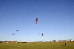 Kite Boarding. People enjoying kite boarding on a summers day at a seaside town Royalty Free Stock Photos