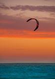 Kite  boarding sail on technicolor horizon and sea Royalty Free Stock Photos