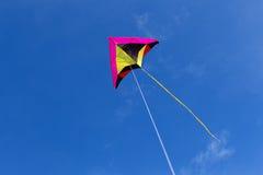 Kite in the bright blue sky. Stock Image
