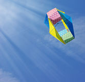 Kite in bright blue sky Stock Photography