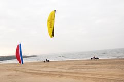 Kite Buggy. Two buggy kiters on the beach Royalty Free Stock Photo