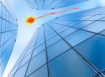 Kite in the city sky Royalty Free Stock Photos