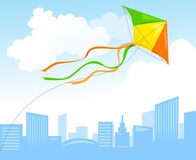 Kite and city skyline Royalty Free Stock Photo