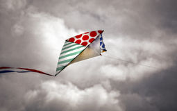 Kite on a cloudy sky Royalty Free Stock Photography