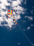 Kite with cloudy sky Stock Photos