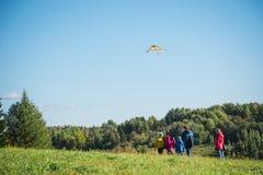 Kite and family Stock Photos