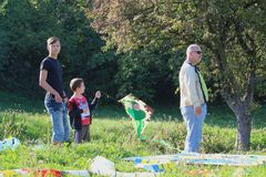 Kite festival - father and his two sons with their kite royalty free stock photography
