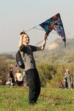 Kite festival - young man with his kite stock image