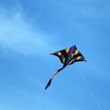 Kite flies free colored in sky blue for the amusement of childre Royalty Free Stock Photo