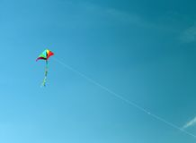 Kite flies high in the sky blue Royalty Free Stock Photography
