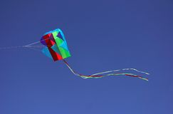 Kite in flight. Colorful parafoil kite in flight with a blue sky background royalty free stock photo