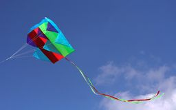 Kite in flight. Colorful parafoil kite in flight with a blue sky background royalty free stock images