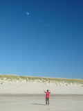 Kite Flyer. Child flying a kite near Cannon Beach on the Oregon coast stock photos