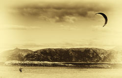 Kite flyer in sea sepia background Royalty Free Stock Image