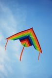 Kite flying. Over the blue sky Royalty Free Stock Image