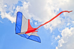 Kite. Flying kite in the air against the blue sky stock image