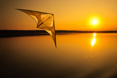 Kite Flying At Sunset Stock Photo