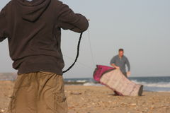 Kite flying on beach. Preparing to fly a kite on beach Stock Photography