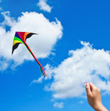 Kite flying in a beautiful sky clouds Stock Photos