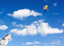Kite flying in a beautiful sky clouds Stock Photo