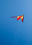 Kite flying on blue sky. Kite flying on clear blue sky Stock Photography