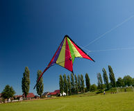 Kite flying on blue sky Stock Images
