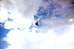 Kite. Flying in the blue sky Royalty Free Stock Photo