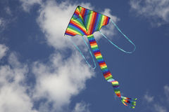 Kite Flying, bright strips colours Royalty Free Stock Photo