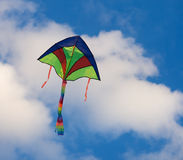 kite flying in a clear blue sky Royalty Free Stock Image