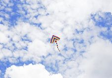 Kite flying in the clouds royalty free stock photo