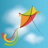 Kite flying in cloudscapes Royalty Free Stock Image