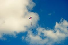 Kite. A kite flying high in the sky Royalty Free Stock Image