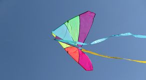 Kite flying high in the sky blue Stock Image