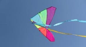 Kite flying high in the sky blue Stock Image