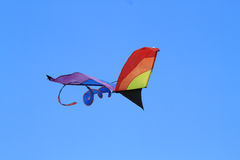 A kite flying over a  blue sky Royalty Free Stock Photography
