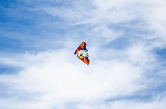 Kite flying over blue sky Stock Photography