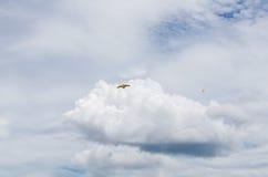 Kite flying over blue sky Stock Photo