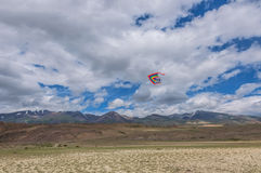 Kite flying sky mountains Stock Images