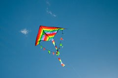 Kite flying in the sky. Kite flying against the background of clouds Stock Image