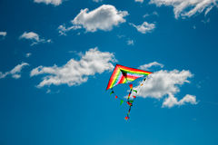 Kite flying in the sky. Kite flying against the background of clouds Royalty Free Stock Photos