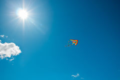Kite flying in the sky. Kite flying against the background of clouds Stock Images