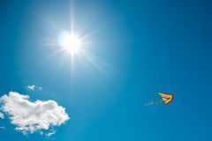Kite flying in the sky. Kite flying against the background of clouds Stock Photography