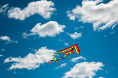 Kite flying in the sky. Kite flying against the background of clouds Royalty Free Stock Photo