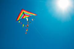 Kite flying in the sky. Kite flying against the background of clouds Stock Photos