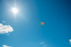 Kite flying in the sky. Kite flying against the background of clouds Royalty Free Stock Images